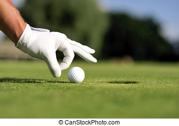 Golf Golf - Handsome player playing golf and shooting in the...