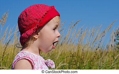 Emotional Little Girl with funny Face Expression