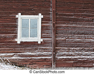 Frosty window of old log home, winter season background