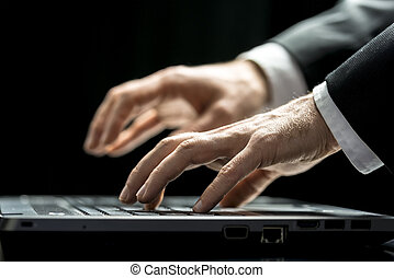 Businessman typing on his laptop computer