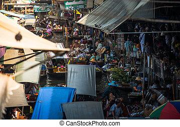 RATCHABURI,THAILAND - Jan 18 : Tourist buying souvenir from...