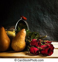 Still life flowers - Brunch of roses placed on wooden table...