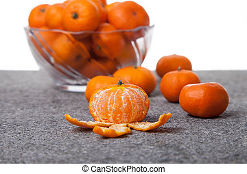 Fresh Clementines fruit peeled with glass bowl
