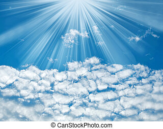 Blue sky with sun rays and clouds, nature background