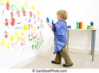 Boy ready to fingerpaint - Painter boy approaching the wall...
