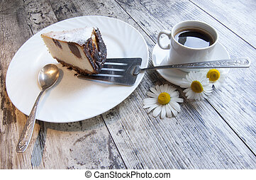 Slice of cheesecake on a white dish with chamomile - Slice...