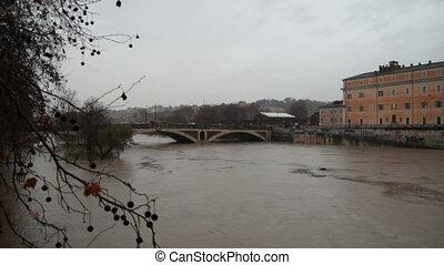 river tiber flood - rising level of river tiber , central...