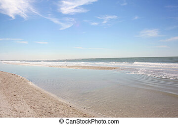 White Sandy Beach and Blue Sky - a beautiful curving white...