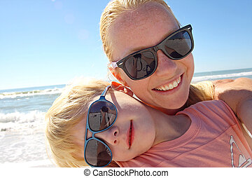 Mother and Son Self Portrait on Beach - a young mother and...