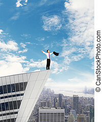 happy businessman standing on building roof on sky...