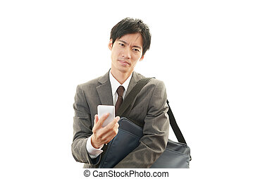 Dissatisfied Asian businessman - Tired and stressed Asian...
