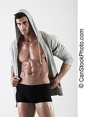 Portrait of a muscle man posing in studio isolated