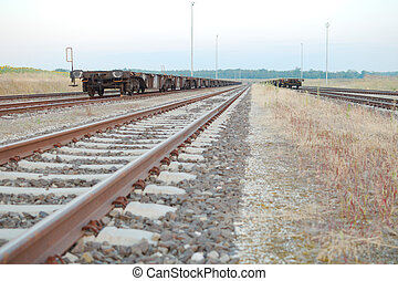 Railway Tracks with Empty Open Wagons Front in the...