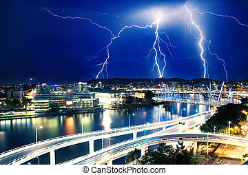 Multiple eletric lightning strikes over river in Brisbane,...
