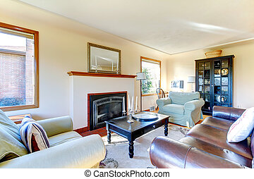 Bright furnished living room with fireplace