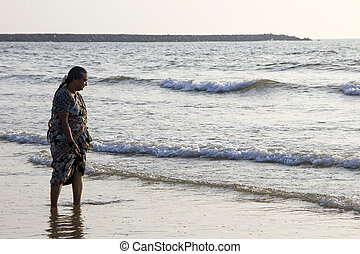 Beholding Sea Waves - Woman curiously observing sea waves at...
