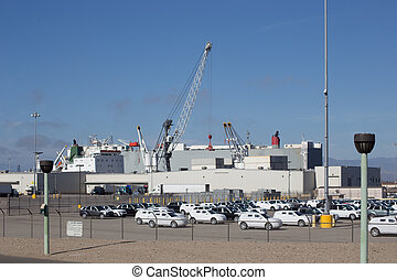 Automotive Cargo Imported - A crane is taking cargo...