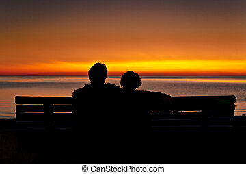 Couple at Sunset - A romantic couple are watching the sunset...
