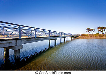 Island Bridge - A bridge spans across the water leading to...
