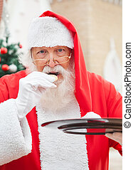 Santa Claus Eating Cookies Outdoors - Portrait of Santa...