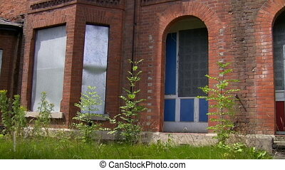 Deserted community houses - Pan shot of abandoned empty...