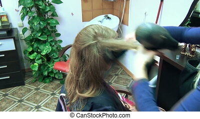girl hair dry blow dryer - Close view of hairdresser drying...