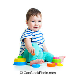 smiling baby playing with toy isolated on white