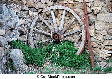Cartwheel - Abandoned wooden cartwheel on the wall Vintage...