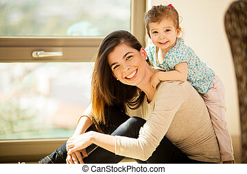Happy mom and her baby girl - Portrait of a gorgeous young...