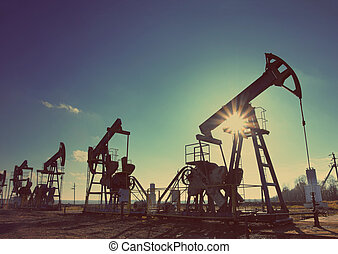 working oil pumps silhouette - vintage retro style