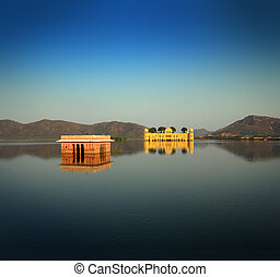 jal mahal - palace on lake in Jaipur India - landscape with...