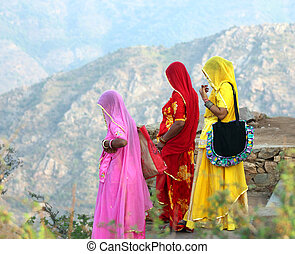 Indian women in colorful saris on top of hill - Indian women...