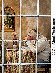 Senior Male Praying - Window View - View of Senior Male,...