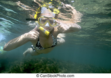 Woman crazy about snorkeling