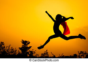 teen girl jumping on the nature