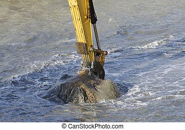 Dredging harbor with excavator - Excavator bucket dredging...