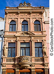 Tenement house with statues