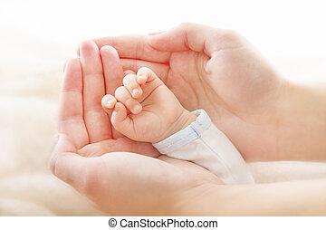 Newborn baby hand in mother hands. Help asistance concept -...