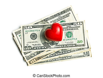heart of stone on american dollars - top view of red heart...