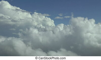 Above the clouds, aerial footage. - Flying above the clouds....