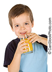 The fresh and healthy fruit juice - Boy having a glass of...