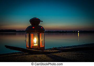 Lantern on the beach at the lake