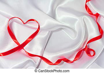 Red ribbon heart - Red satin glossy ribbon heart over white...