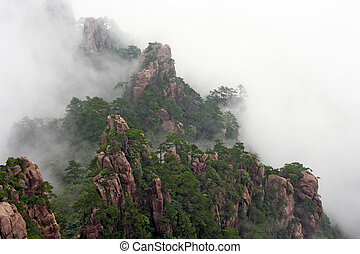 Generic chinese landscape - mist rising over Huang Shan...