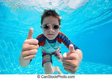 Boy swimming underwater - Portrait of a cute little boy...