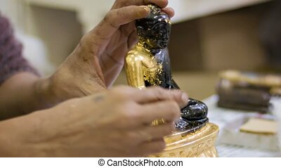 Manually gold plating Buddha figurine - Video 1080p -...