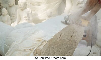 Processing marble Buddha statue in the workshop - Video...
