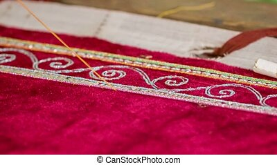 Embroidery in the tapestry workshop. Myanmar. Mandalay -...