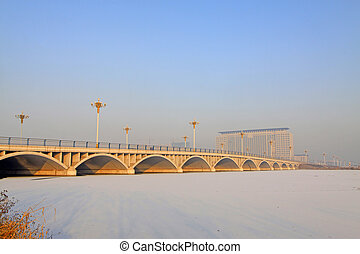 bridges and buildings in the ice river