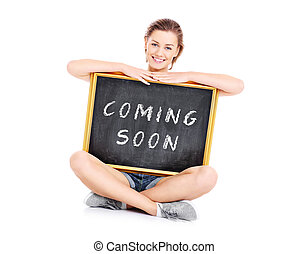 Coming soon! - A picture of a beautiful woman showing a...